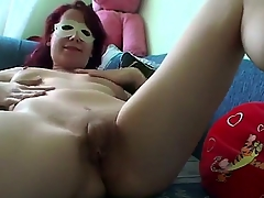 Unruly redhead surprises us with a private masturbation video in sexy mask