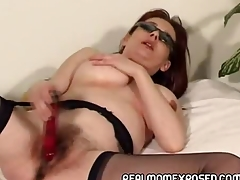 Mature redhead wearing nothing wine bar her shades and stockings plays with her aged pussy