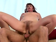 Marvelous mature lady Dalan is doing the best blowjob in the younger guys life, pleasing him nicely while he is getting one's hands involving on the couch. Enjoy the hot video.