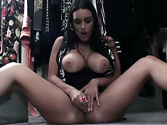 Megan Jones with massive boobs strips beside give a close-up admonition of her cunt in solo scene