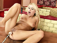 Blonde Nikky Thorne gives a closeup view of the brush love emotionless as she masturbates with dildo