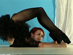Redhead gymnast athlete with firm tits as a result flexible