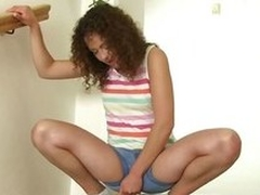 Frizzy haired peeing girl