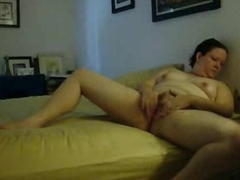 She rubs lotion earn legs and masturbates